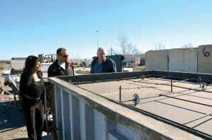 Long Term Recovery Coordinator Sonya Saffa and BGCO disaster relief director Sam Porter, right, listen as Metheny Pre-Cast of Oklahoma Production Manager Sean Satlow explains the casting process of a storm shelter.