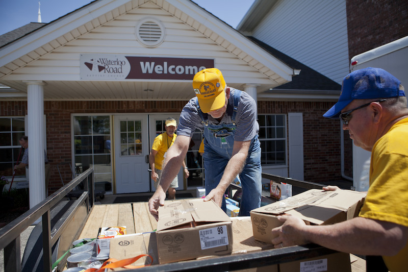 On Monday, May 5, volunteers with the Baptist General Convention of Oklahoma's Disaster Relief operation unload supplies for the hundreds of meals they will prepare for first responders and others who are serving in the Guthrie area. From left, volunteers are Brad Biddy, Larry Fordyce and Bill White. (Photo: Jonathan Burkhart)