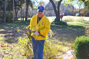 Disaster Relief Blue Cap Jack McAlester helps remove tree limbs. (Photo: Chris Doyle)