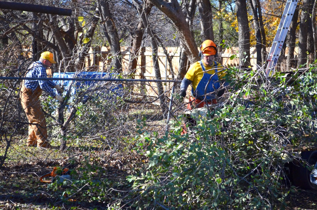 Disaster Relief volunteers work on multiple yards that were affected by the recent ice storm. (Photo: Chris Doyle)